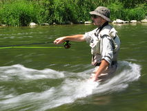 Fly fishing. In summer wild nature Stock Image