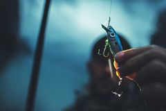 Fly Fishing Bait Closeup. Angler Fisher Equipment. Late Evening Hours royalty free stock photography