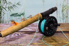 Fly fishing box flies on a wooden platform on the river Royalty Free Stock Images