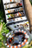 Fly fishing bugs and road with real Royalty Free Stock Image