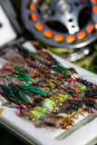 Fly fishing bugs and road with real Royalty Free Stock Images