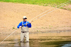 Fly fishing (casting) Royalty Free Stock Images