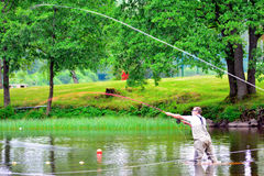 Fly fishing (casting) Stock Images