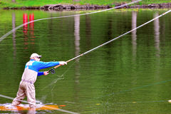 Fly fishing (casting) Royalty Free Stock Photo
