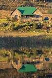 Fly Fishing Cottage. Reflection of a Fly fishing cottage on a lake Royalty Free Stock Images