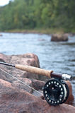 Fly fishing. Detail of a cork handled fishing rod and reel Royalty Free Stock Images