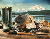 Fly fishing equipment on deck of mountains Royalty Free Stock Image