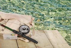 Fly fishing equipment on a dock Stock Photo