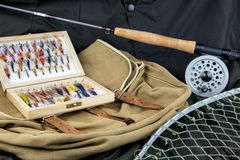 Fly Fishing Equipment and Game Bag on Outdoor Coat Stock Images