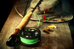 Fly fishing equipment with old hat royalty free stock photos