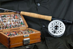 Fly Fishing Equipment and Outdoor Coat Stock Photos