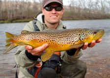 Free Fly Fishing - Fisherman With Large Fish Stock Image - 22818861