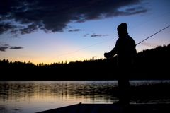 Fly fishing. Man by the lake Royalty Free Stock Photography