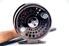 Fly fishing gear. A metal fly fishing reel and rod Royalty Free Stock Photos