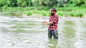 On The Fly Fishing hobby and sport activity. bearded fisher in water. summer weekend. Happy fly fishing. fisherman show
