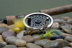 Fly Fishing III. Flyfishing Tackle with three colorful popping bugs royalty free stock photo