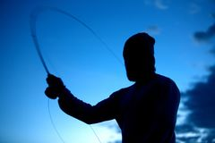 Fly fishing. Man by the lake Stock Photo