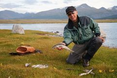 Fly fishing in Mongolia. Fly fishing on Lake Hoton Nuur in Mongolia Royalty Free Stock Images