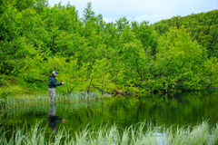 Fly fishing on the mountian lake Royalty Free Stock Photos