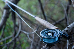 Fly fishing. A ready for fishing  fly fishing rod and antique Hardy reel Royalty Free Stock Image