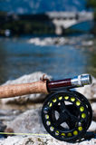 Fly fishing reel. On white stone Stock Photos