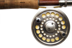 Fly Fishing Reel White Background. Closeup of a fly fishing reel on a white background with yellow line on the spool Royalty Free Stock Image