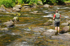 Fly fishing on the River Lyn, Devon Stock Image