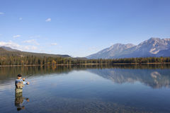 Fly Fishing In Rocky Mountains, Alberta, Canada Stock Photo