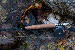 Fly fishing rod and classic reel. In clear chalk-stream Royalty Free Stock Images