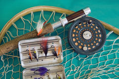 Fly fishing rod and net Stock Photos