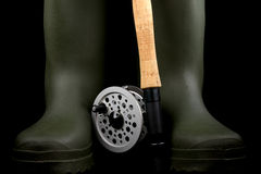 Fly Fishing Rod and Reel with Wading Boots on Black Background Stock Photography