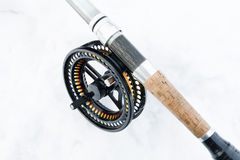 Fly fishing rod on white close up Royalty Free Stock Photography
