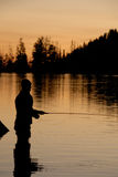 Fly Fishing silhoutette 2. Fly fishing silhouette at Boulder Lake near McCall, Idaho Royalty Free Stock Photo