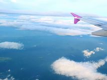 Fly Fishing. Fly tour jet air aircraft plane wing clouds travel sky Royalty Free Stock Photo