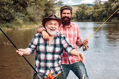 Fly fishing for trout. Fishing. Fisherman fishing with spinning reel. Man fishing. Fly fishing in the pristine stock photo