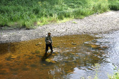Fly fishing for trout and greyling Stock Photos