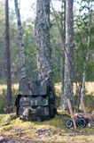 Fly fishing. Two fly fishing rods and a rucksack on the bank, evergreen forest Scandinavia Stock Photography