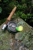 Fly Fishing V. Fly fishing equipment with green and yellow popping bug stock photography