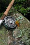 Fly Fishing VII. Fly fishing rod and reel with a popping bug used for catching bass royalty free stock photos