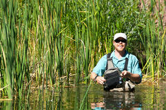 Fly Fishing with Wadders royalty free stock photography