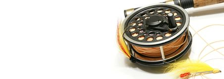 Fly Fishing Web Banner. Fly fishing rod and reel with selection of fishing flies. web banner - internet background - header for website Royalty Free Stock Image