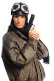 Fly Girl. Hispanic woman in a vintage aviator costume holding a gun on a white background Stock Image