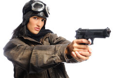 Fly Girl. Hispanic woman in a vintage aviator costume holding a gun on a white background Stock Images