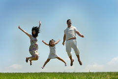 Fly happy family on blue sky Royalty Free Stock Images