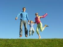 Fly happy family on blue sky Royalty Free Stock Photography