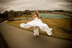 Fly happy woman7. Runaway bride in the field during a stormy windy day Royalty Free Stock Images