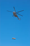 Fly helicopter with cargo Stock Image