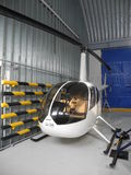Fly. Helicopter Robinson R44 in the hangar Royalty Free Stock Photos
