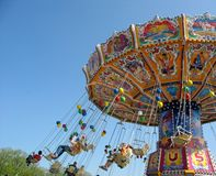 Fly In The Sky - Small Colourful Carousel Stock Image