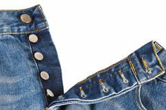 Fly of the jeans with button closure. Fly of the blue jeans with button closure over a white background stock image